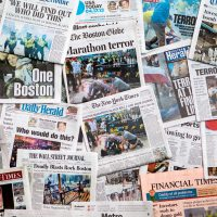 Boston Marathon Bombing headline collage featuring globe